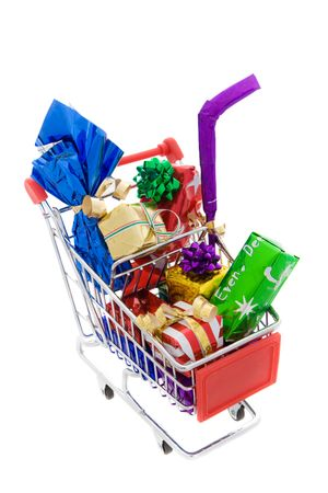 Shopping cart full of different presents on a white background Stock Photo - 5790613