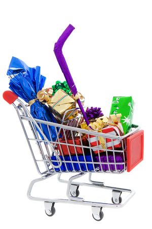 Shopping cart full of different christmas presents on a white background Stock Photo - 5790614