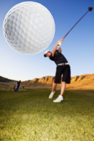play golf: A golfer driving the ball down the fairway focus on the ball