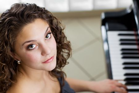 A pretty girl playing the piano portrait photo