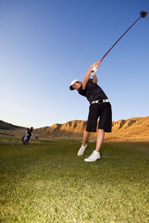 flying man: A golfer driving the ball down the fairway