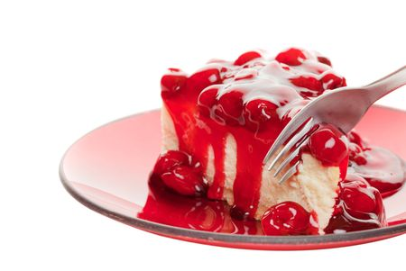 A fork slicing into a piece of cherry cheese cake on a white background 版權商用圖片 - 6443225