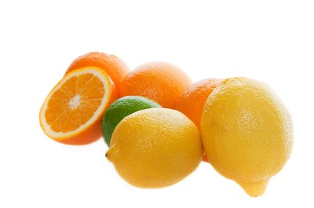 Fresh fruit on a white background with focus on front lemons Stock Photo