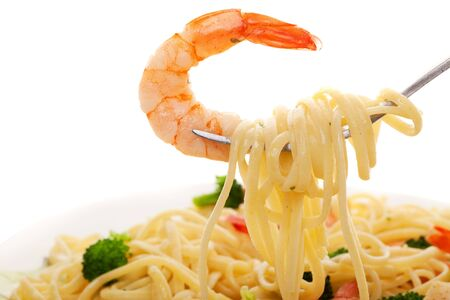 A fork with linguine and shrimp on a white background, Focus on the shrimp photo