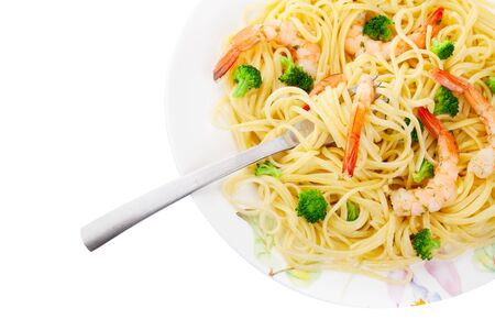 A plate of linguine with shrimp and broccoli isolated on white photo