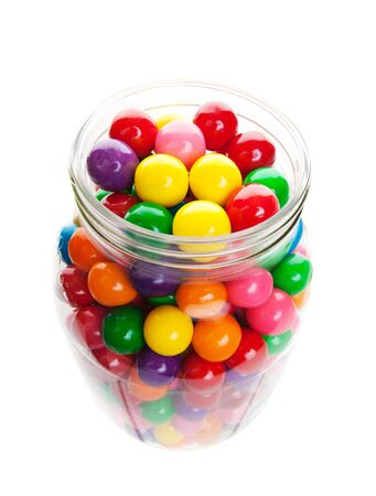 Old style jar packed with colorful gumballs photo