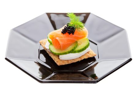 Salmon with  cucumber and goat cheese, garnished with dill.  photo