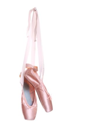 Hanging pink ballet shoes isolated on a white background photo