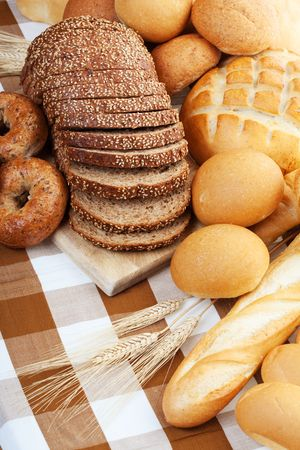 Assortment of baked bread on a table cloth photo