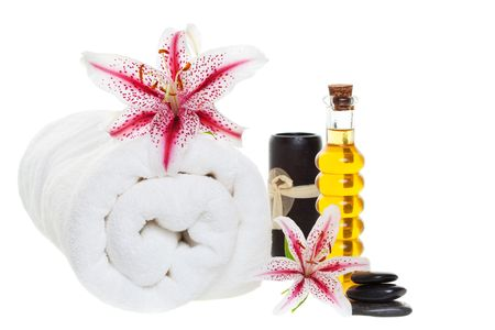 essences: Spa products with stones, aromatic candles on a white background  Stock Photo
