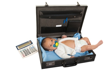 Newborn baby in a briefcase, a working mother concept