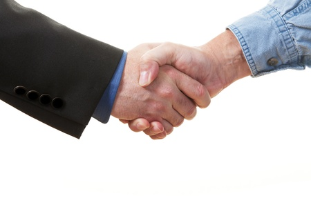 Closeup of a handshake on a white background  photo