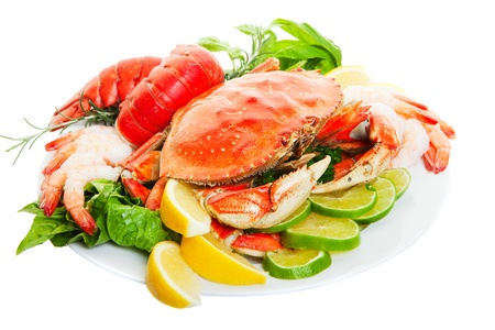 lobster isolated: Platter of crab and lobster tails, focus on the crab. Stock Photo