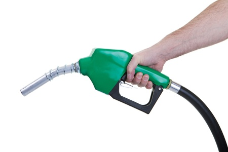 A man holding a green gasoline nozzle on a white background. photo