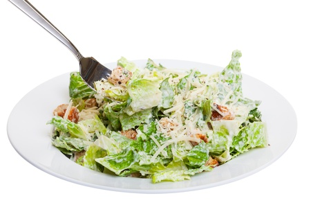 salad fork: Healthy ceasar salad isolated on white  Stock Photo
