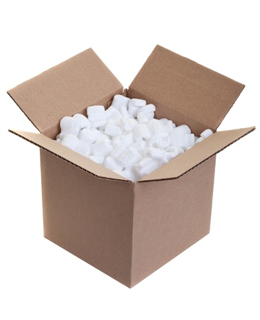 Cardboard box with styrofoam packing peanuts on white