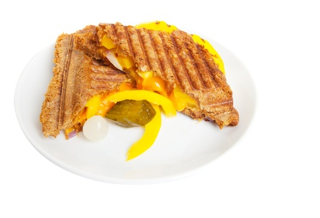 Grilled sandwich or panini with melting cheese,peppers, and  onions, on wholewheat bread.