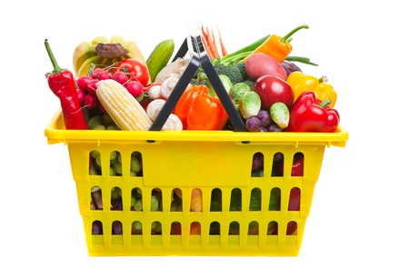 Photo of a yellow shopping basket full of fresh fruit and vegetables, isolated on a white background. Stock Photo - 13339070