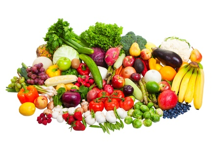 A large group of fruit and vegetables isolated on a white background.