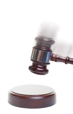 A gavel striking down on a block with motion blur added photo