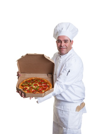 A smiling chef holding a pizza in a take out box