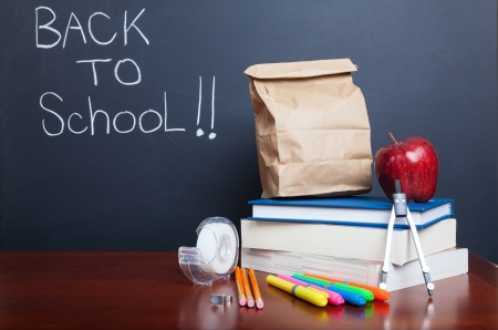 book bags: Back to school, school books with apple and  paper bag lunch on desk
