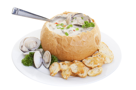 Clam chowder soup in bread bowl isolated on a white background. 版權商用圖片