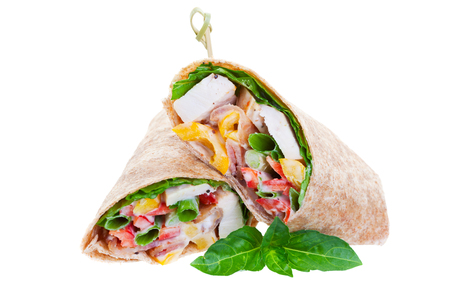 Healthy whole wheat chicken wrap on a white background.