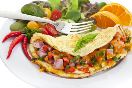 Home made Omelet with cheese and salad.Close up with focus on the Omelet 版權商用圖片