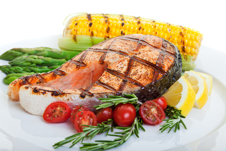 grilled salmon steak with vegetables corn and asparagus 版權商用圖片