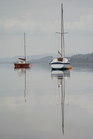 reflaction: Boats moored on Lake Bala in Wales - portrait orientation Stock Photo