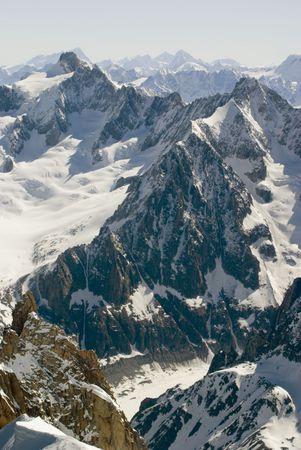 midi: View of Mont Blanc mountain range from Aiguille Du Midi in Chamonix - portrait orientation Stock Photo