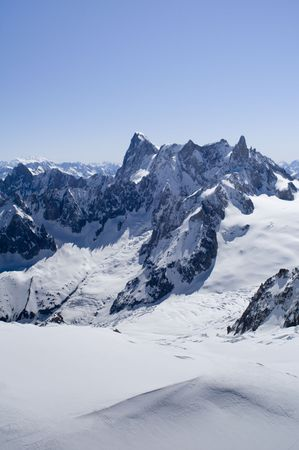 crevasse: View of Mont Blanc mountain range from Aiguille Du Midi in Chamonix - portrait orientation Stock Photo