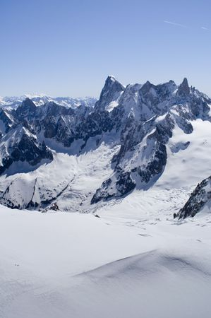 aiguille: View of Mont Blanc mountain range from Aiguille Du Midi in Chamonix - portrait orientation Stock Photo