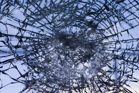 Window shattered by high velocity impact   - landscape orientation photo