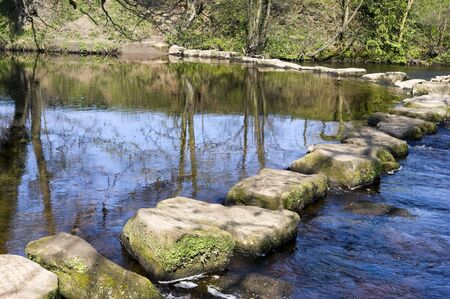 Stepping stones in the river Derwent Peak District National Park Stock Photo - 4848556