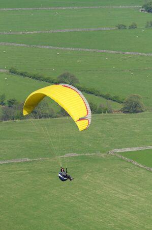 derbyshire: Paraglider over Castleton Peak District National Park Derbyshire England