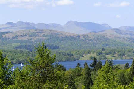 View of Lake Windermere and mountains from Bowness Lake District National Park Cumbria England photo