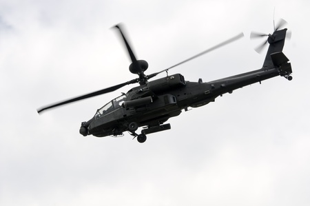 raf waddington: WADDINGTON, ENGLAND, UK - JULY 2: Apache Longbow attack helicopter at Waddington International Air Show on July 2, 2011 in Waddington, England, UK. Flown by WO2 Bruce Allen and Captain Scottie Hewitt.