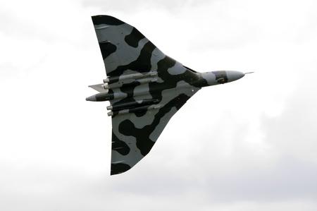 cold war: WADDINGTON, ENGLAND, UK - JULY 2: Last flying Avro Vulcan B.2 XH558 cold war bomber at Waddington International Air Show on July 2, 2011 in Waddington, England, UK.