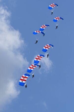raf waddington: WADDINGTON, ENGLAND, UK - JULY 2: RAF Falcons Parachute Team at Waddington International Air Show on July 2, 2011 in Waddington, England, UK.