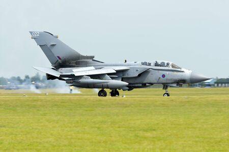 raf waddington: WADDINGTON, ENGLAND, UK - JULY 3: Tornado GR4 from XV(R) Squadron RAF at Waddington International Air Show on July 3, 2011 in Waddington, England, UK.