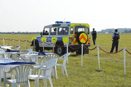 raf waddington: WADDINGTON, ENGLAND, UK - JULY 3: Royal Air Force Police investigate a suspicious package while on airfield patrol at Waddington International Air Show on July 3, 2011 in Waddington, England, UK. Editorial