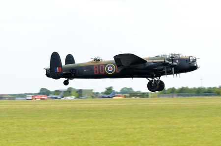 raf waddington: WADDINGTON, ENGLAND, UK - JULY 3: Avro Lancaster at Waddington International Air Show on July 3, 2011 in Waddington, England, UK.