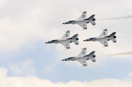 usaf: WADDINGTON, ENGLAND, UK - JULY 3: USAF  Thunderbirds in close formation at Waddington International Air Show on July 3, 2011 in Waddington, England, UK.