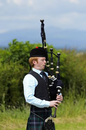 STIRLING, SCOTLAND, UK - JULY 10: Solo piper at Stirling Highland Games on July 10, 2011 in Stirling, Scotland, UK. Bagpipe playing as performed at traditional well run games are distinctly national and characteristically Scottish. Nowhere else will you f