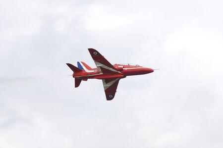 raf waddington: WADDINGTON, ENGLAND, UK - JULY 2: The Red Arrows aerobatic display team at Waddington International Air Show on July 2, 2011 in Waddington, England, UK.