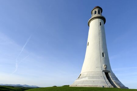 sited: Sited approximately one mile from Morecambe Bay. The Sir John Barrow Monument is 100ft tall. It is built of limestone quarried from nearby Birkrigg Common. Stock Photo