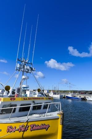 Cheticamp, Nova Scotia - August 24th, 2011: Fishing boats moored in Chesticamp Harbour Cape Breton Island Nova Scotia Canada