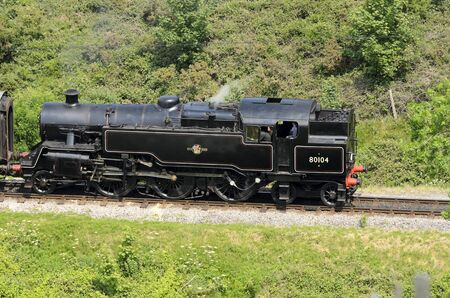 br: CORFE CASTLE, DORSET, UK - JUNE 4: BR Standard Class 4 80104 on Swanage Railway Line near Corfe Castle on June 4, 2011 in Dorset, England, UK. Editorial